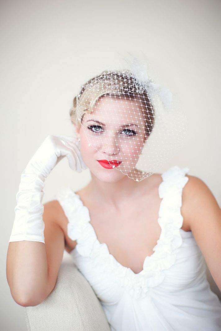 vintage bride with red lips birdcage veil