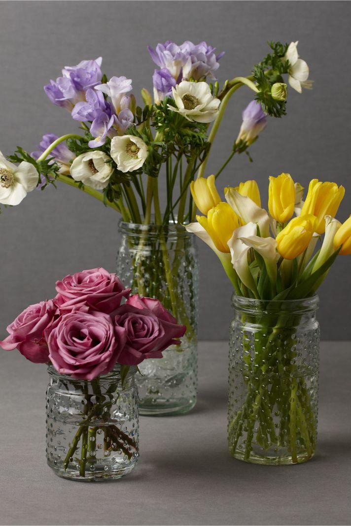 vintage wedding centerpieces mason jars with bright flowers