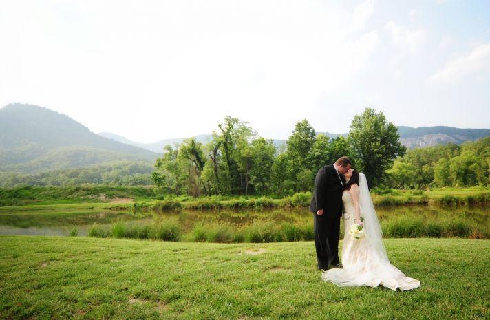 bride groom kiss at outdoor wedding ceremony