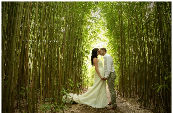bride groom kiss beneath high bamboo destination wedding