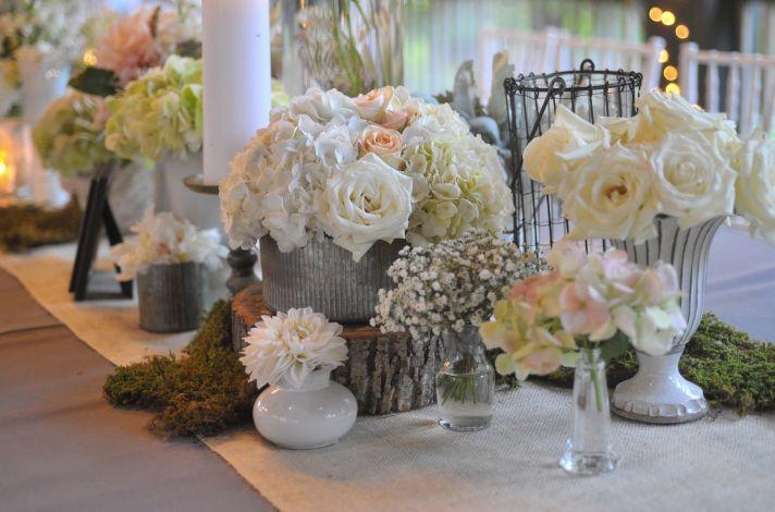 elegant real wedding North Carolina wedding photographers romantic centerpieces roses babys breath