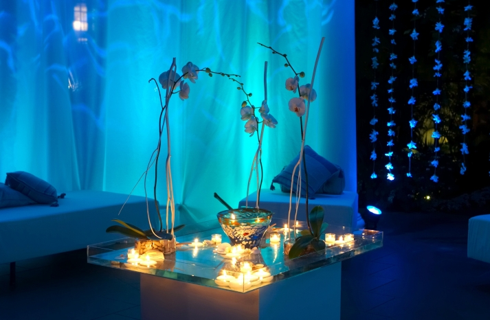 wedding details reception decor inspiration by Jerri Woolworth blue lighting orchid centerpieces