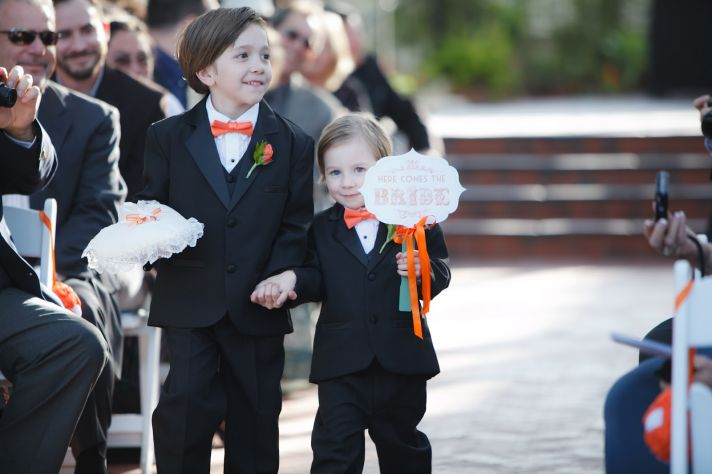 cute ring bearers priceless wedding photos orange black white