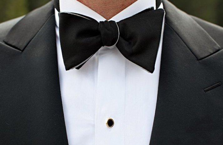 elegant black tie groom bow tie