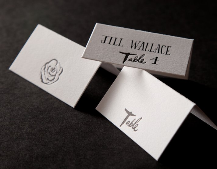 modern wedding escort cards embossed roses