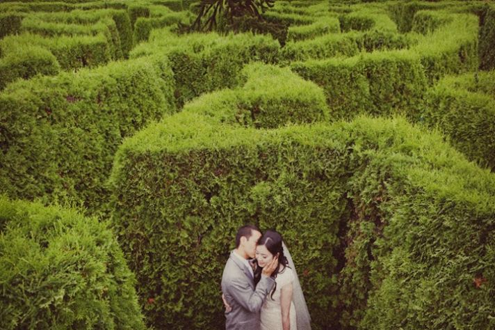 Bride and Groom embrace in lush garden
