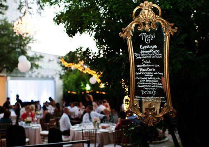 Vintage wedding idea reception menu scrawled on framed mirror