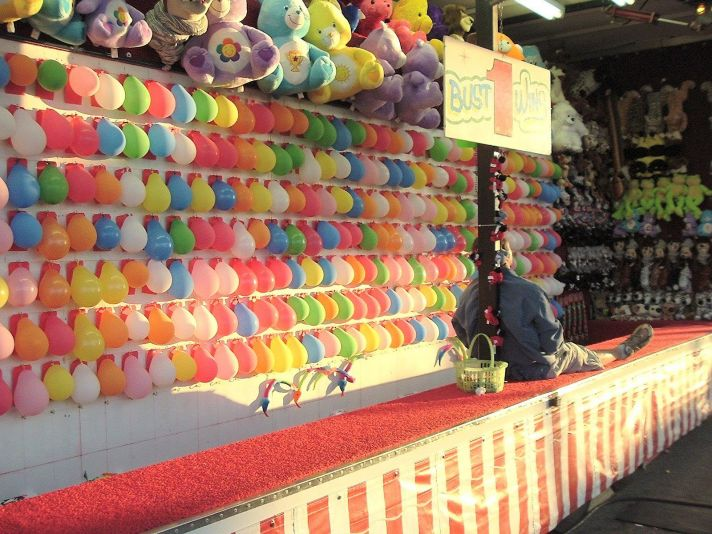 Carnival themed weddings balloon darts