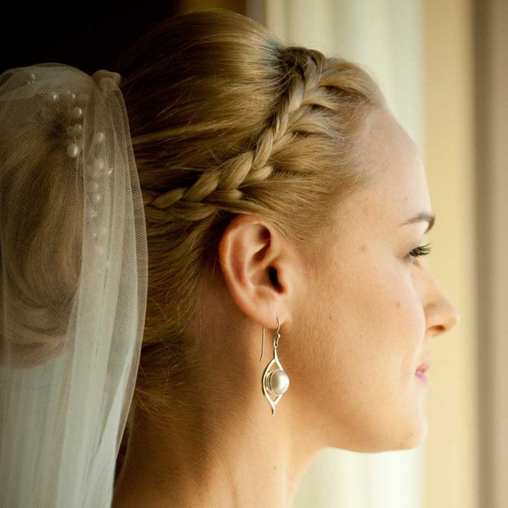 Classic bridal updo with french braid in front