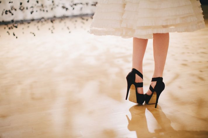 Ivory LWD with ruffled tiers black wedding heels