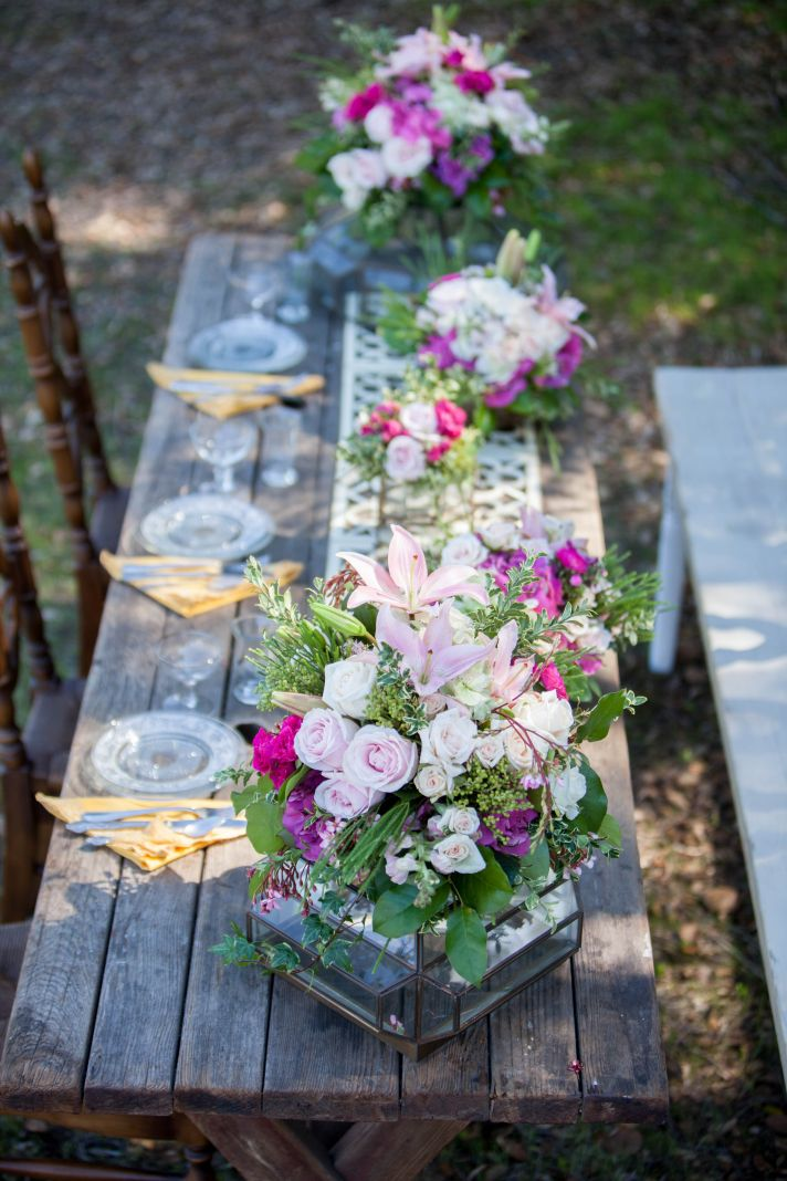 Romantic outdoor wedding reception table vintage chairs