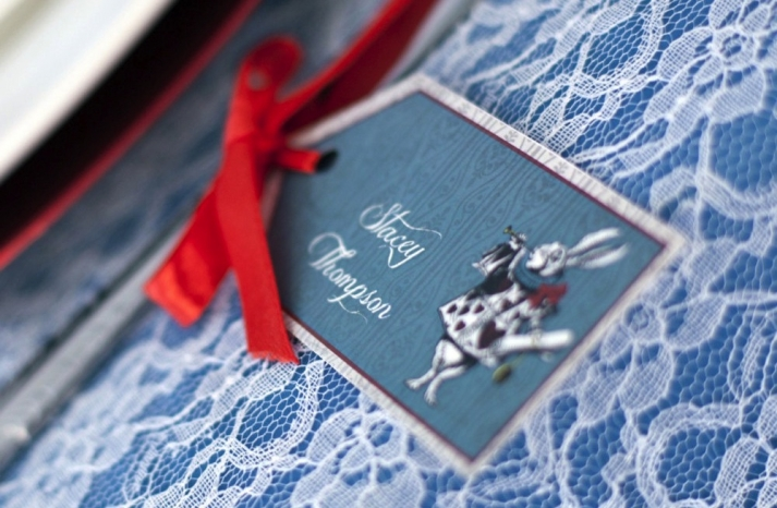 Whimsical wedding escort cards Alice in Wonderland