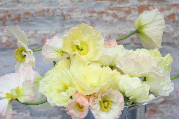 Romantic pastel yellow wedding flower arrangement