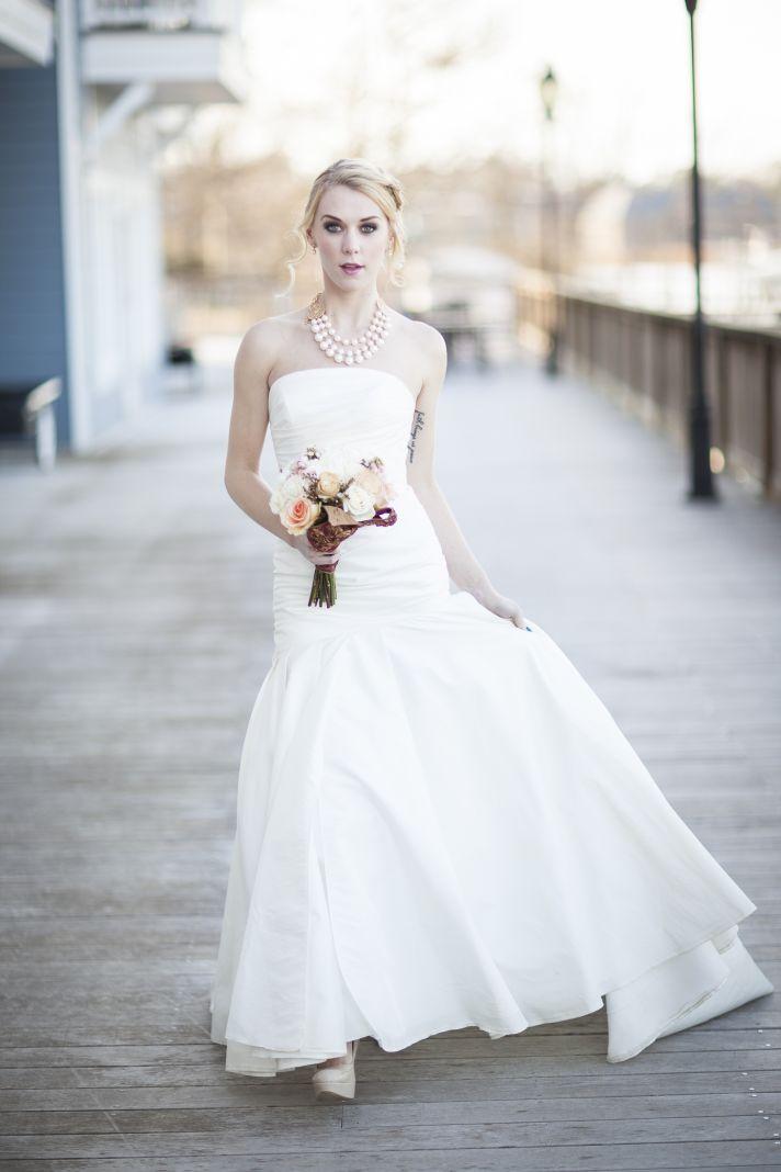 Bride wears white strapless mermaid wedding dress with statement necklace