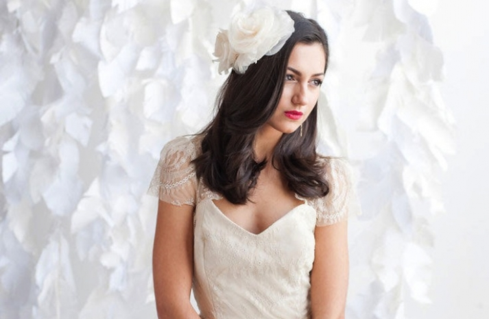 All down wedding hair with large ivory flowers