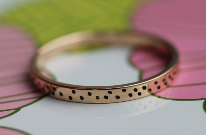Recycled gold wedding band with dots