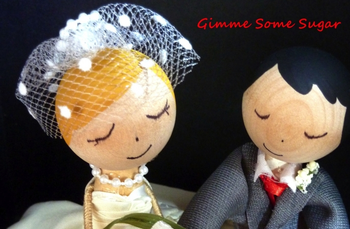 Adorable bride and groom wedding cake topper dotted birdcage veil
