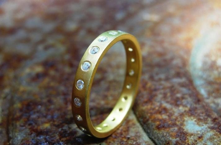 Yellow gold diamond wedding band modern