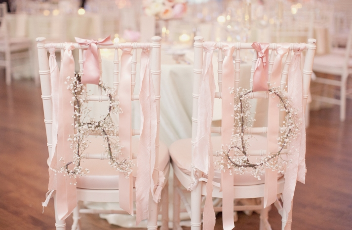 White and pink wedding chair decor for the bride and groom