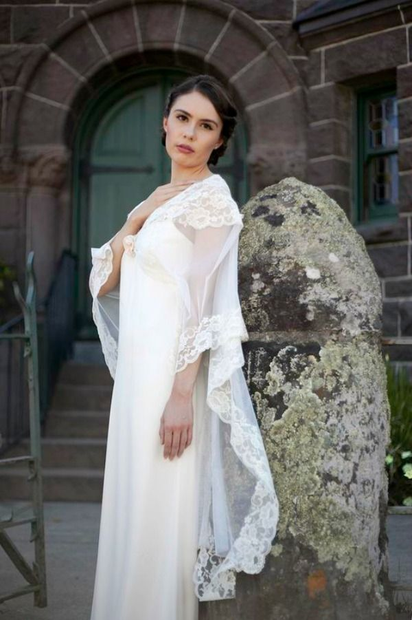 Vintage inspired wedding dress with sheer draped scoop neckline