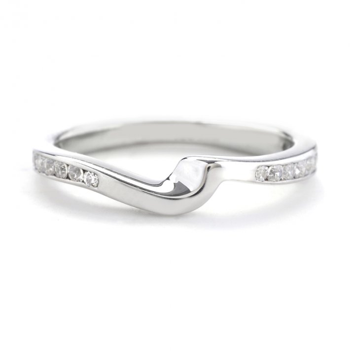 Platinum curve shadow wedding band with channel set diamonds