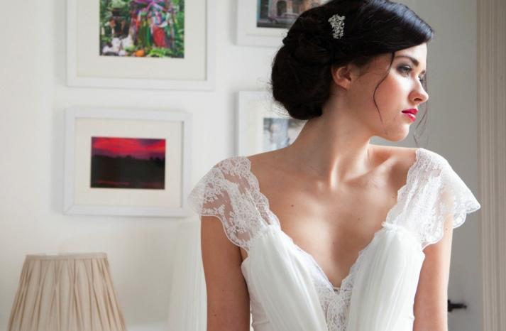 Delicate lace flutter sleeve v neck wedding dress