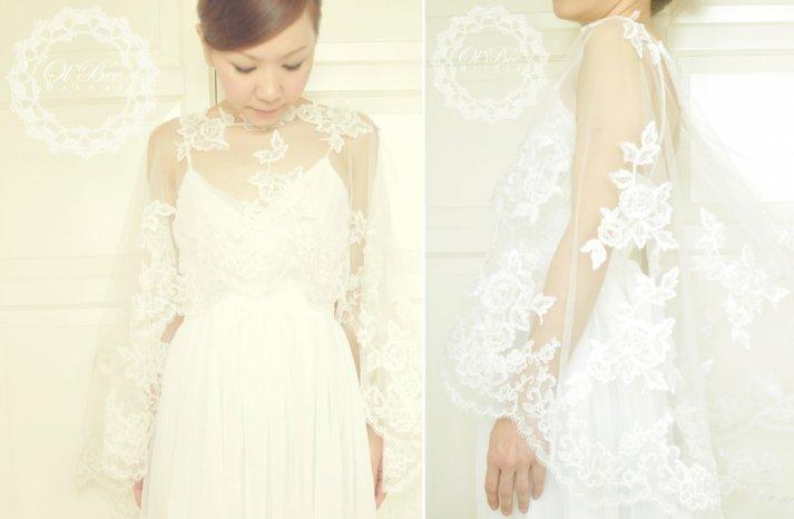 Flowing sheer lace sleeves on romantic wedding dress