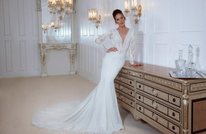 Long sleeved ivory mermaid wedding dress with deep v neck