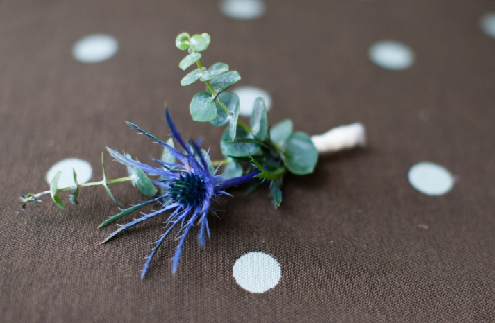 Blue and green grooms boutonniere