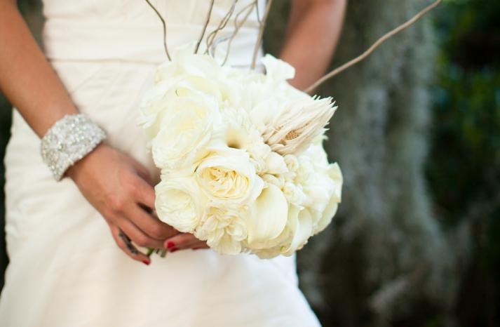 Elegant bride holds cream peony bouquet