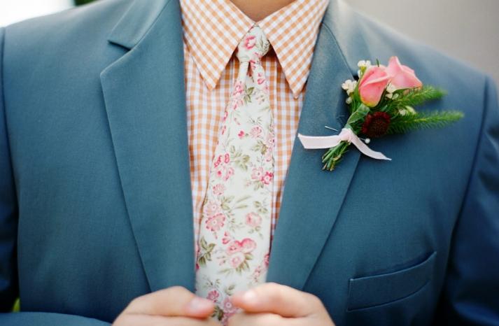 Unique grooms attire with a floral print tie