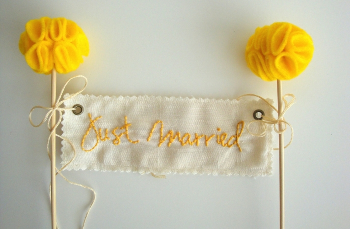 handmade Just Married wedding cake topper in ivory and yellow