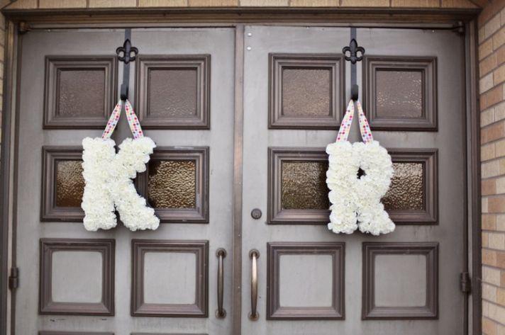 White wedding flower initials with polka dot ribbon