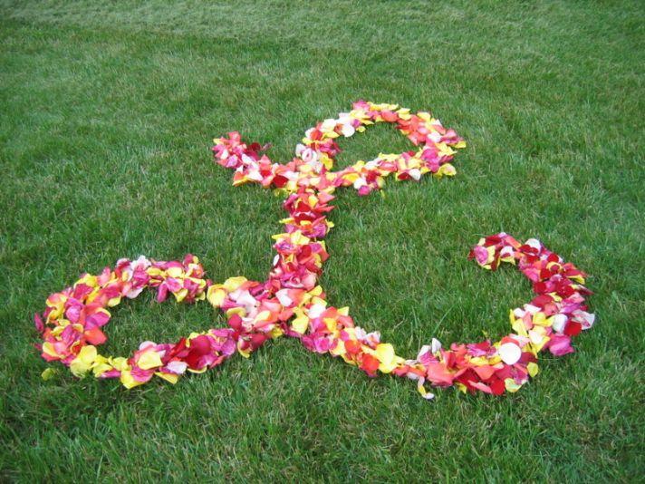 Rose petal wedding initials for ceremony aisle