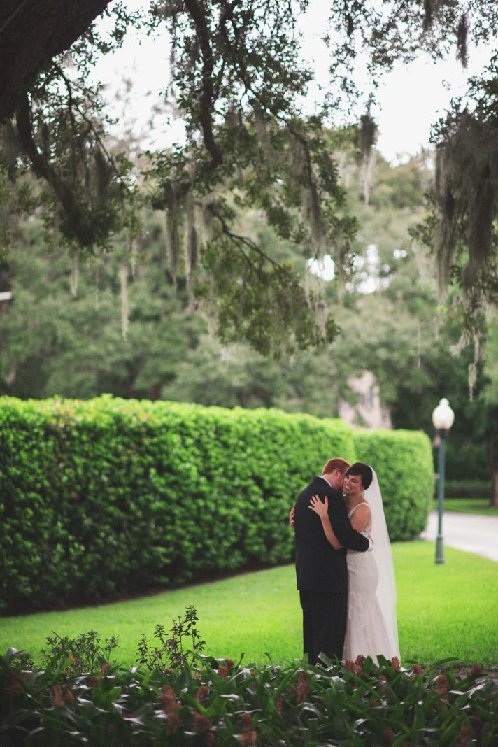 Bride and groom embrace outdoors after saying I Do