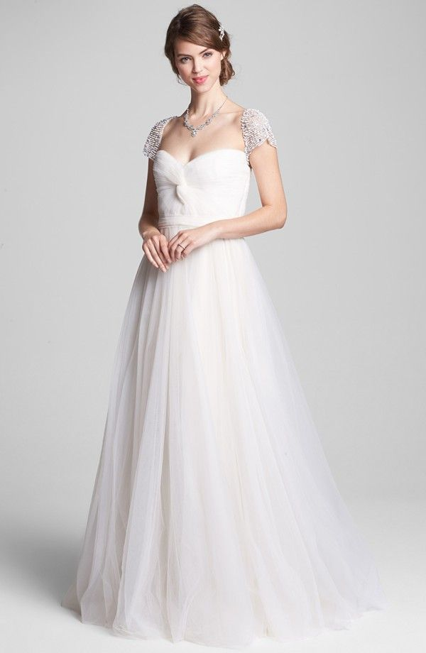 Real brides your favorite designer wedding dresses onewed for Wedding dresses with roses on them