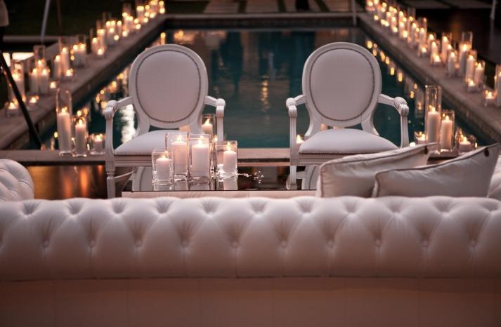 candle lit wedding reception around a pool