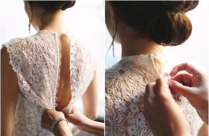 Bride wears lace statement back wedding dress with covered buttons