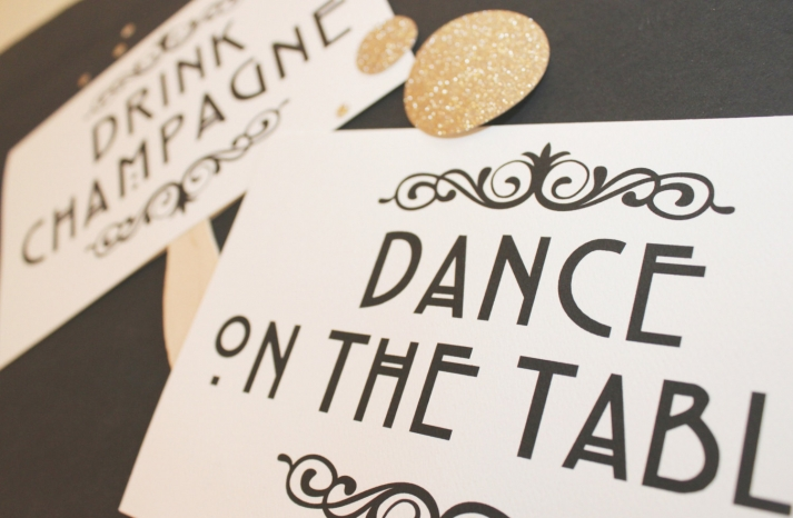 art deco inspired wedding photo booth props in cream black and gold