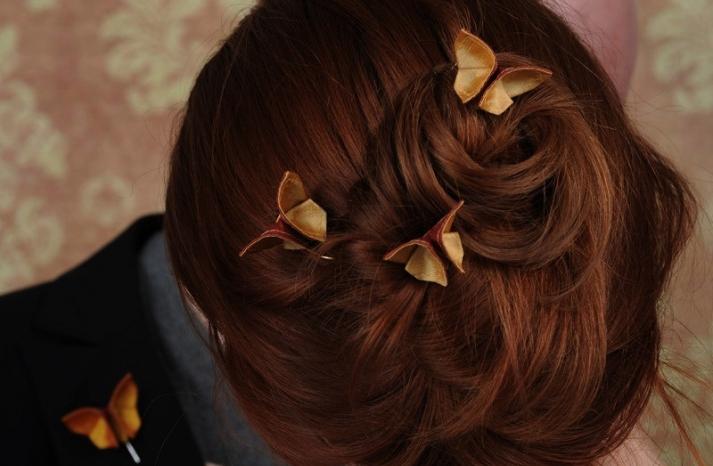 small origami butterflies adorn romantic wedding updo