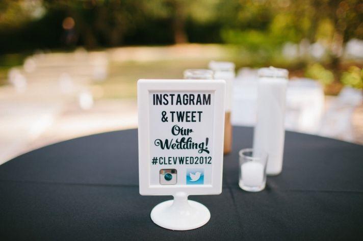 Wedding reception plugged hashtag sign