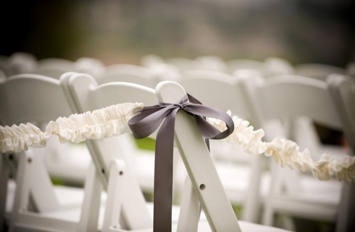 ruffled wedding ceremony aisle decor with mauve ribbons