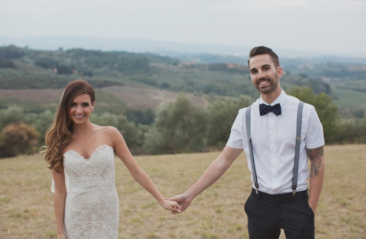 Cool casual groom in bow tie and suspenders