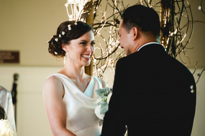 Rustic elegant wedding bride and groom take vows