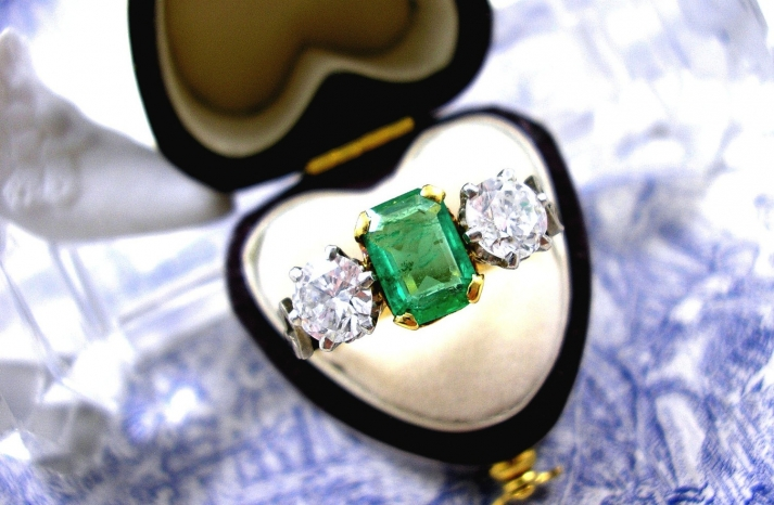 3 stone art deco engagement ring with emerald and diamonds