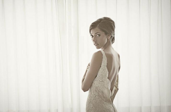 bridal portrait featuring low back lace wedding dress