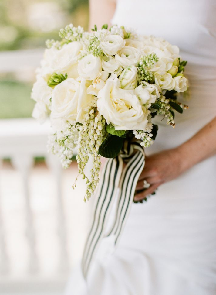 classic ivory wedding bouquet with cream and green striped ribbon