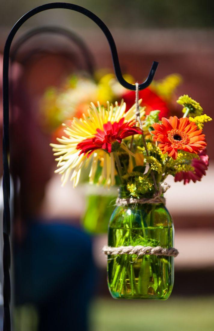 Ceremony aisle flowers on shepards hooks