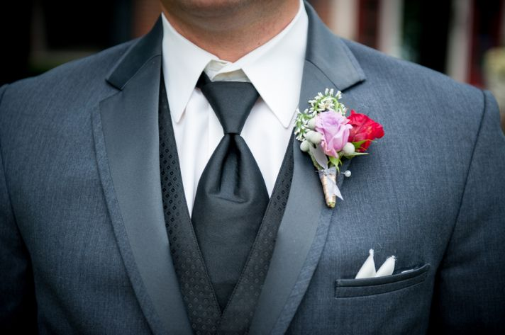Groom in classic grey tux and boutonniere