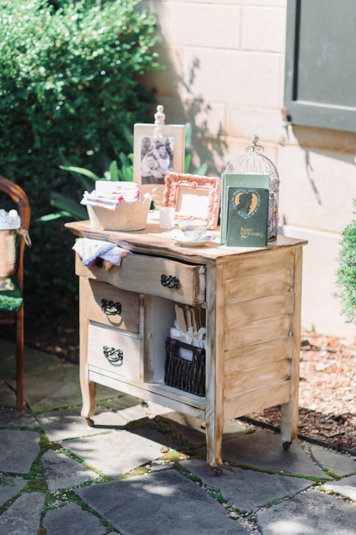 Guest book table in an antique dresser